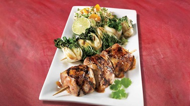 Honey-garlic pork tenderloin brochettes, bok choy brochettes and mandarin rice