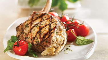 Chops stuffed with grilled vegetables and goat cheese