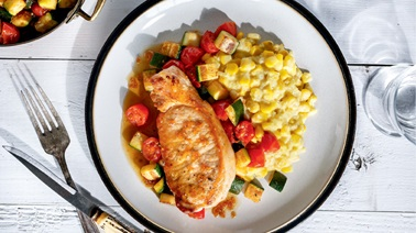 Pork Chops with Creamed Corn and Cherry Tomatoes from Ricardo
