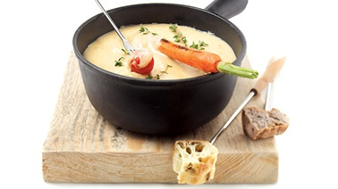 Fondue meal with a tray of grilled vegetables