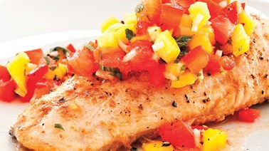 Walleye fillets with crushed tomatoes and mango