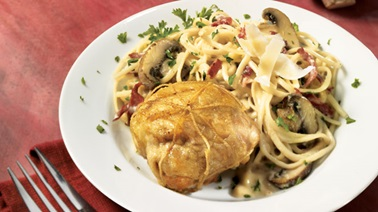 Stuffed chicken thighs on linguine with mushroom cream sauce