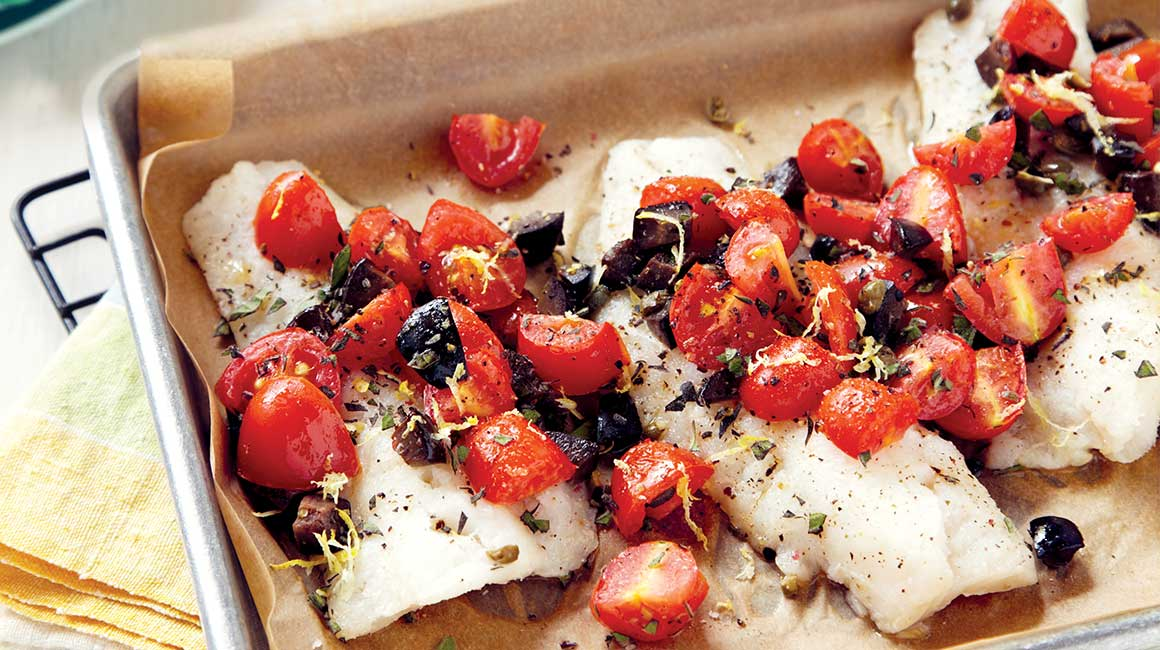 Grilled haddock with capers, olives, and tomatoes