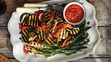 Grilled eggplant and green onions with red pepper-almond sauce
