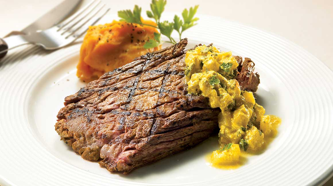 Marinated flank steaks with light turmeric and pineapple sauce