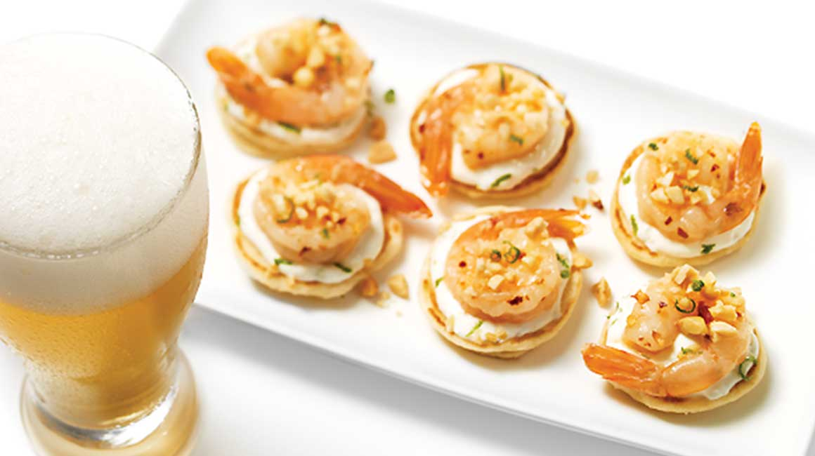 Sweet and sour blinis with shrimp