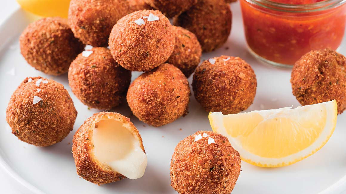 Fried bocconcini with lemon, herbs
