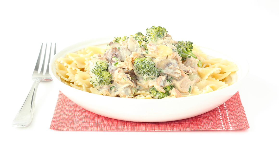 Bow tie pasta with braised pork, mushrooms, broccoli, and goat cheese