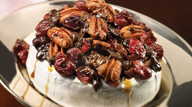 Warm Brie with pecan, cranberry and dark chocolate topping