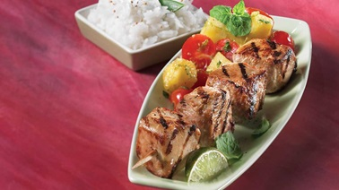 Turkey brochette with pineapple and cherry tomato salad