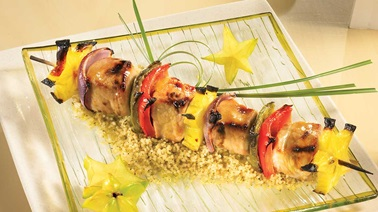 Pork and exotic fruit kebabs