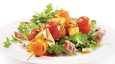 Grilled Candi-to and Zima tomato and cheese brochette on a bed of arugula