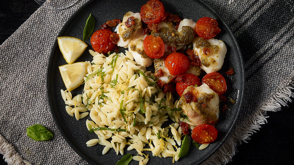 Cod Cheek with Candied Tomatoes and Pesto Oil over Lemon Orzo