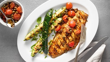 Grilled striped bass with cherry tomatoes and capers from Stefano Faita