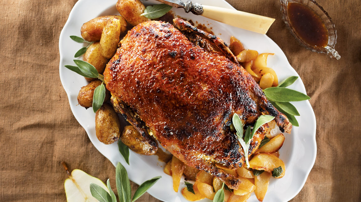 Parmesan-crusted duck with grilled pears