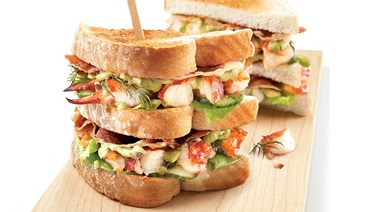 Lobster club sandwich with sweet lime mayonnaise and avocado