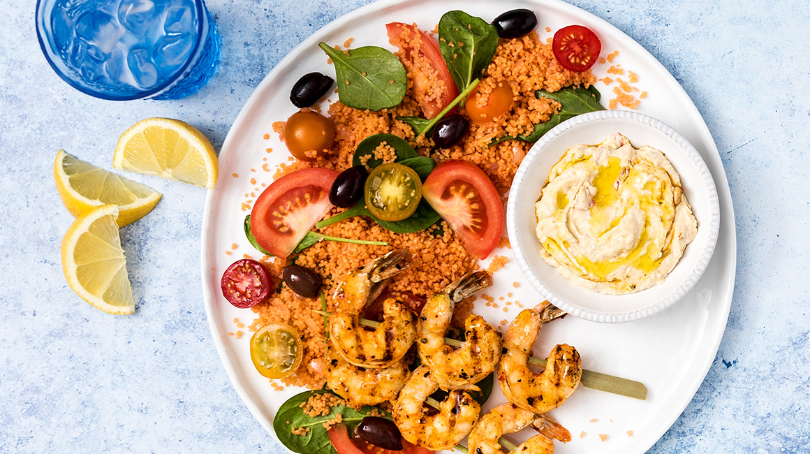 Spicy Shrimp Skewers on Bloody Caesar, Tomato, and Spinach Couscous