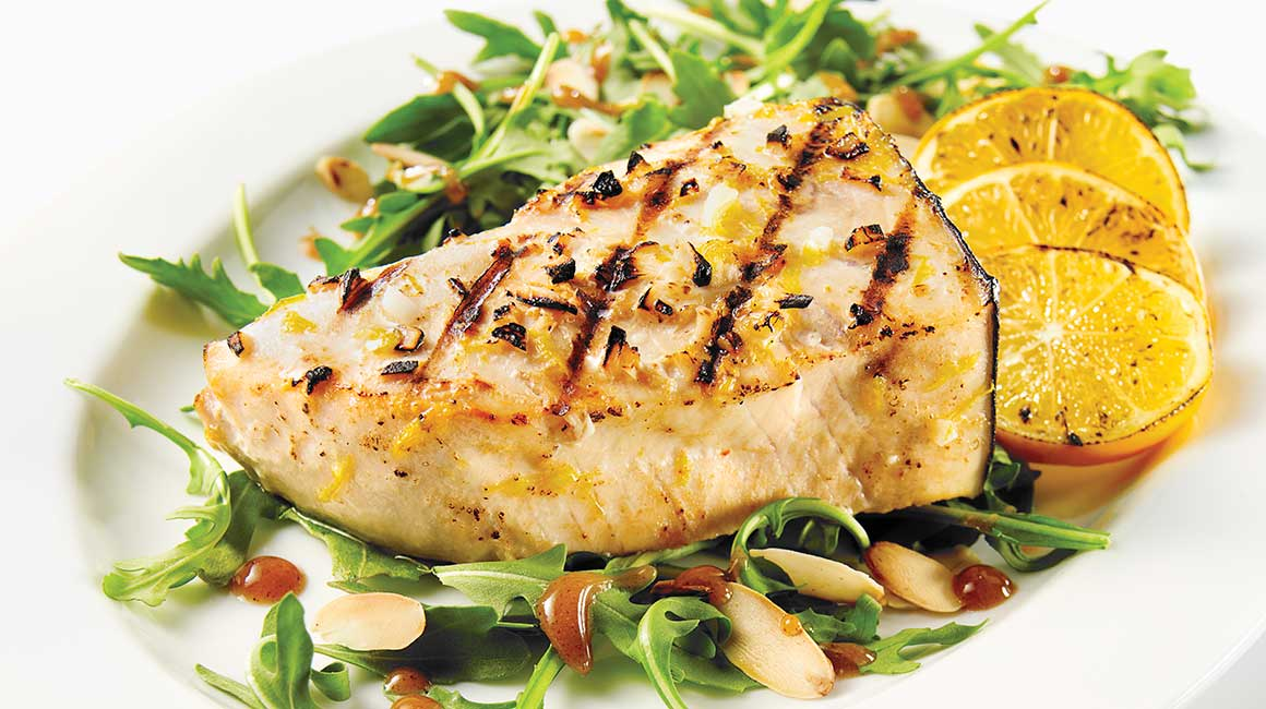 Swordfish Steak in a White Wine marinade over Amandine Arugula