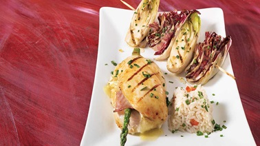 Chicken cutlets stuffed with asparagus and cheese with grilled endive and radicchio and herbs