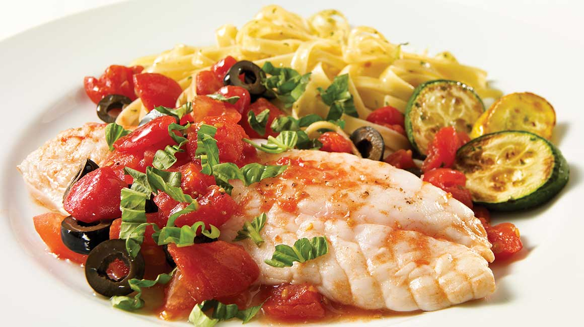 Ocean perch fillet with tomatoes and olives