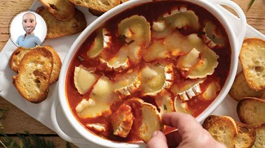 Warm goat cheese with tomato sauce