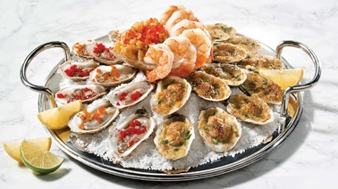 Broiled oysters with Parmesan and garlic