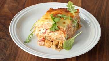 Lasagna with seafood, ricotta, and arugula rosé sauce