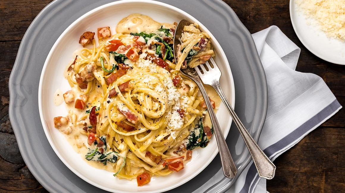 Linguine carbonara with bacon, tomato, and spinach