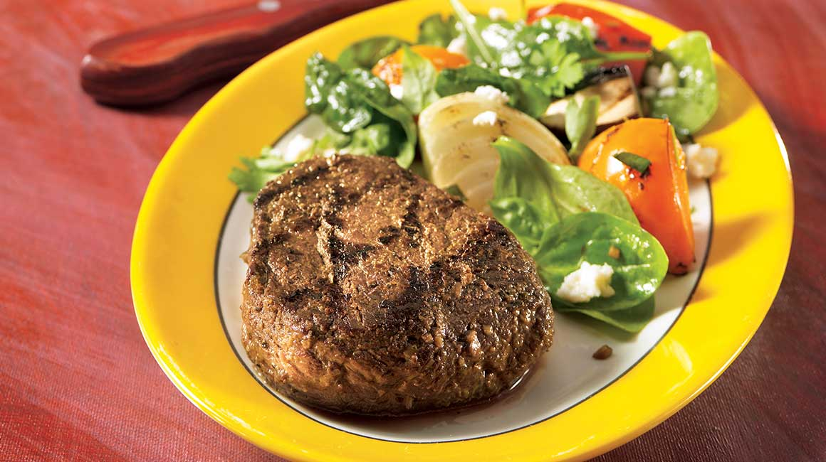 Pesto and garlic blossom venison medallions with grilled vegetable and feta salad