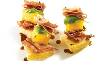 Mango and serrano ham mini brochettes with balsamic coulis