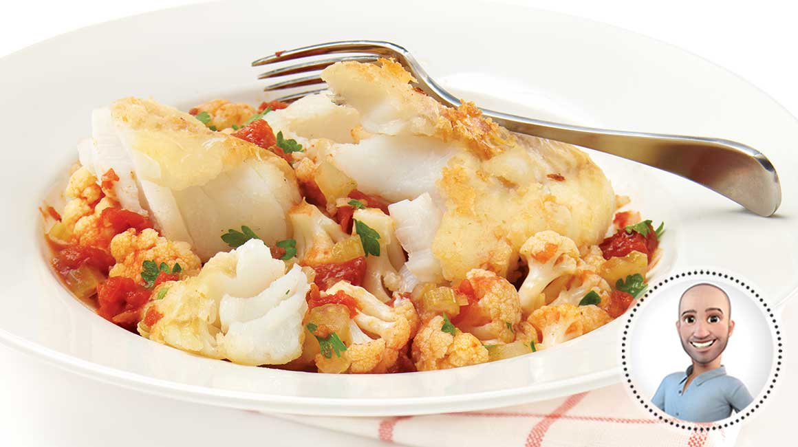 Pan-fried cod over cauliflower and tomatoes