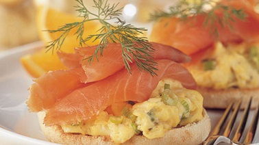 Scrambled eggs with smoked salmon on English muffins
