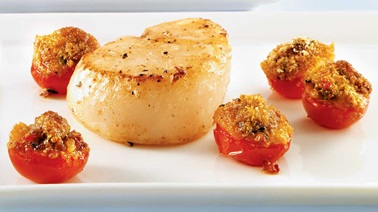 Seared scallops with roasted pesto tomatoes