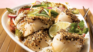 Sesame scallops with Asian peanut and vegetable stir-fry