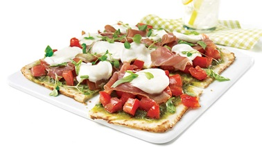 Grilled pizza with buffalo mozzarella and serrano ham