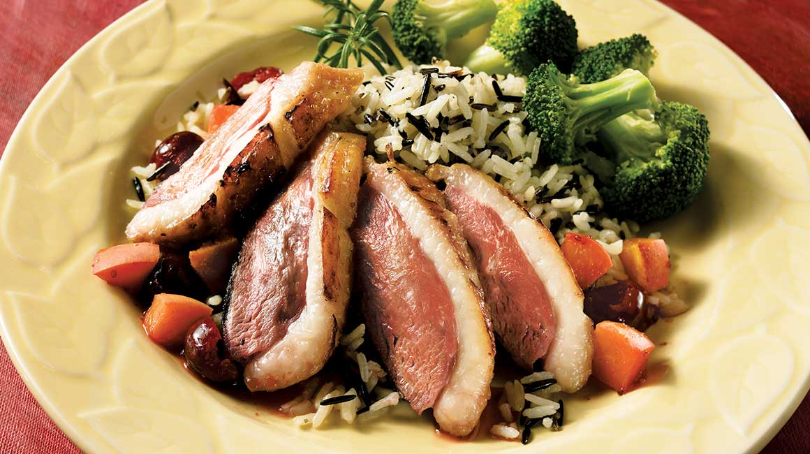 Duck breasts and papillote of sweet and sour fruit