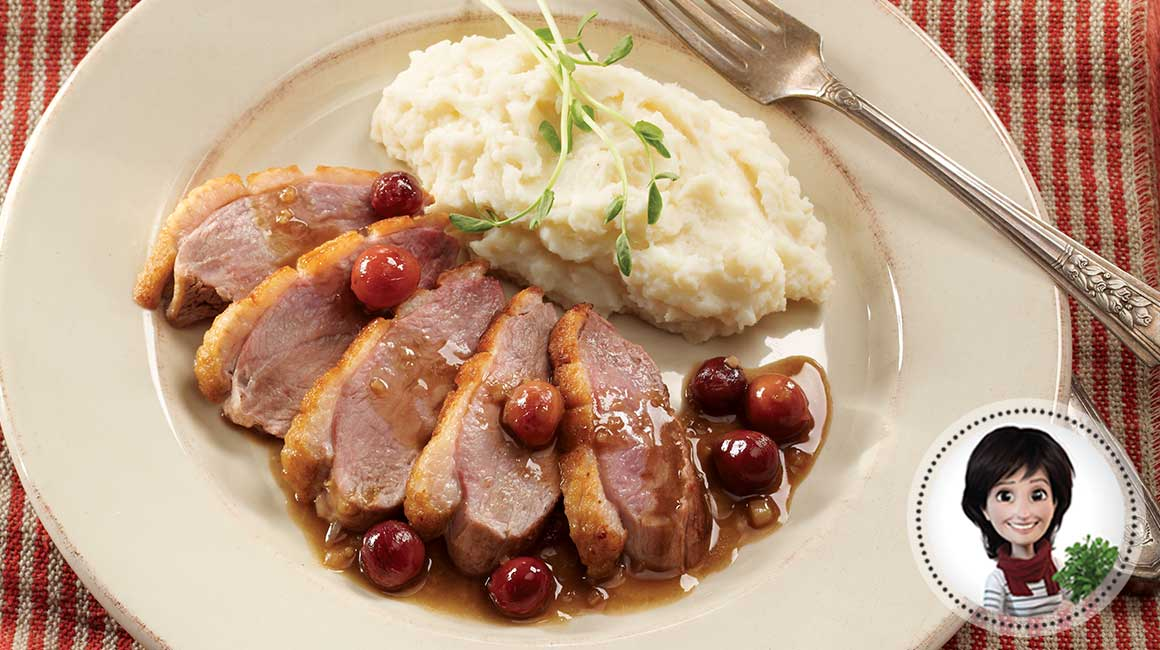 Pan-fried duck breasts with roasted grapes