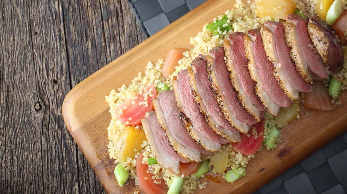 Duck breasts on a bed of quinoa