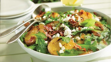 Grilled potatoes with feta and arugula