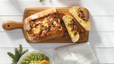 Cheesy country-style bread with eggs, bacon and mushrooms