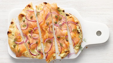 Smoked salmon pizza on naan bread