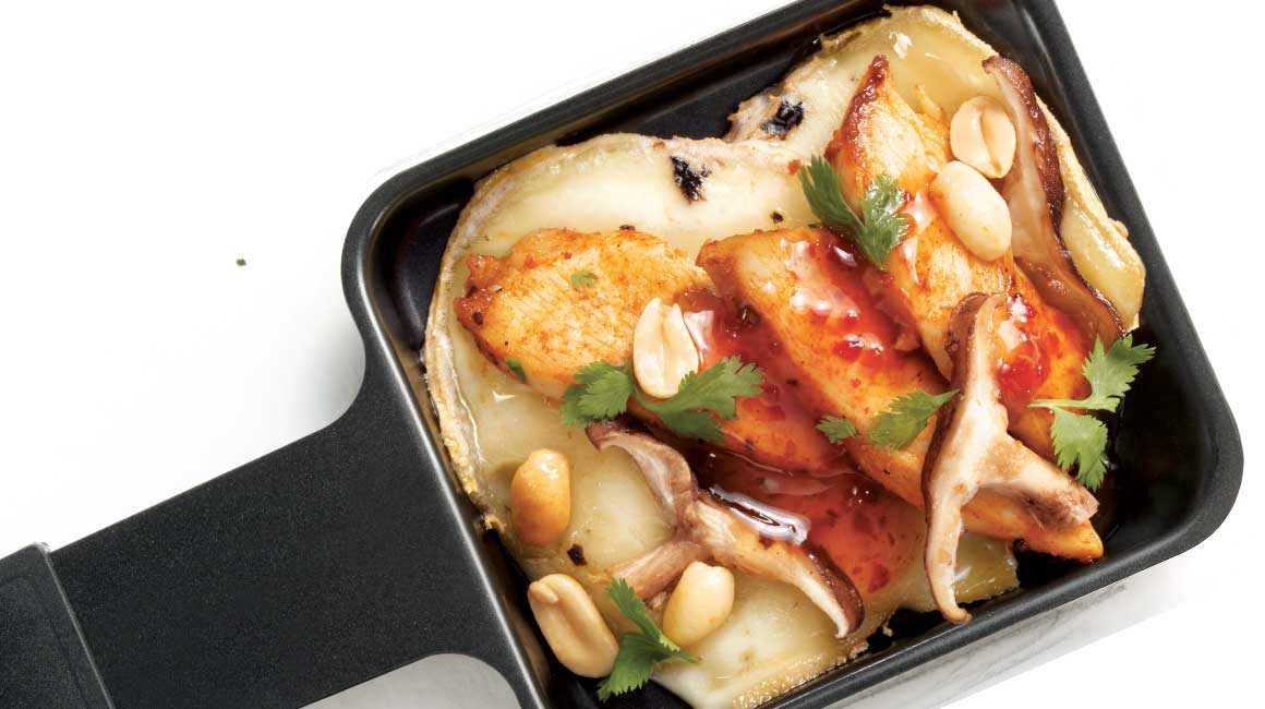 Oka Raclette cheese with Thai chicken and mushrooms