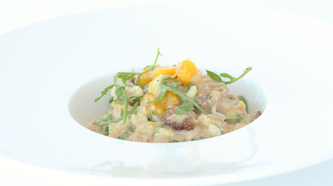 Pork osso buco risotto with roasted squash and goat cheese