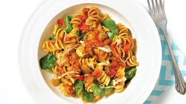 Rotini with meat sauce, spinach, and cheese
