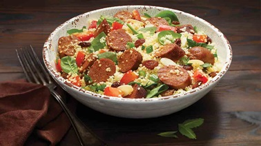 Couscous salad with vegan sausages