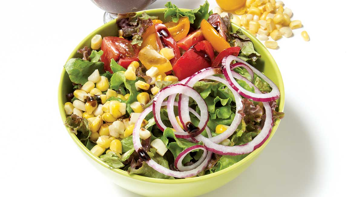 Green salad with corn and tomatoes