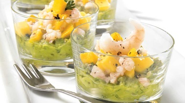 Shrimp and mango salsa over guacamole