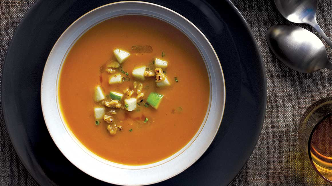 Pumpkin soup with apple-walnut topping