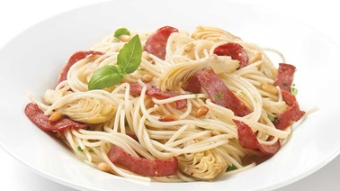 Spaghettini with artichokes pine nuts and salami
