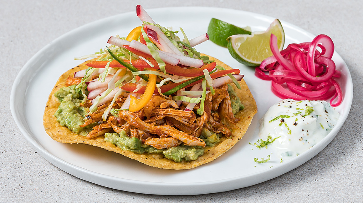 Avocado and lime chicken tostadas with crunchy apple coleslaw